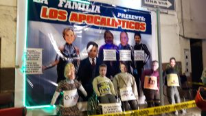 Effigies of 5 of the 8 presidential candidates. A large plastic banner was drapped behind saying The Family Presents The Apocalyptics