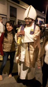 Dia de los Inocentes Parade: The Pope with bottle of liquor